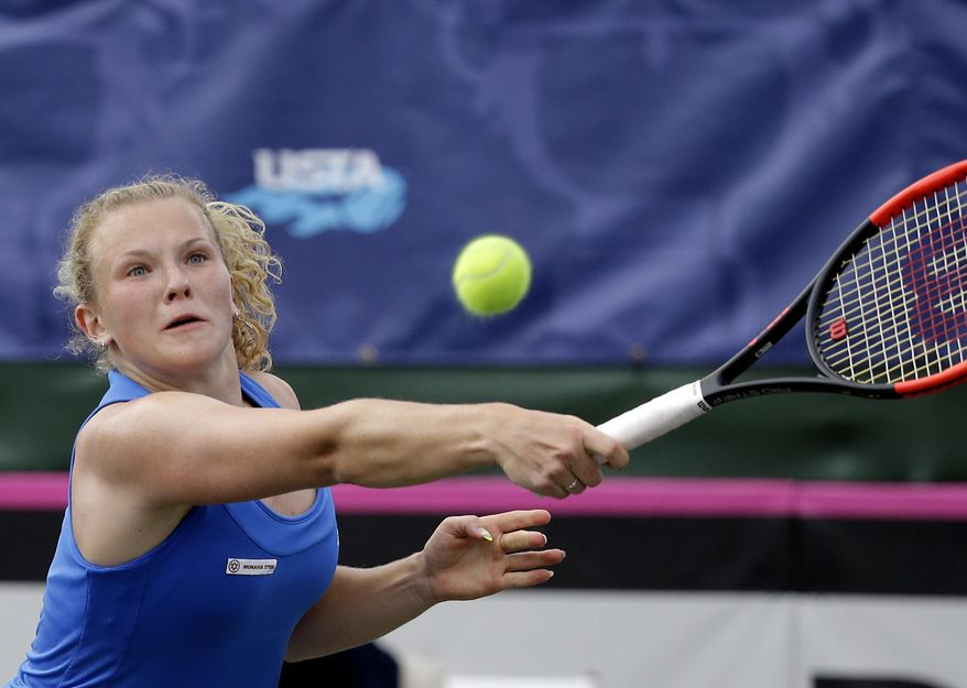 Czech Republic's Katerina Siniakova playing with teammate Kristyna Pliskova returns a shot to United States players, CoCo Vandeweghe and Bethanie Mattek-Sands during a Fed Cup semifinal doubles tennis match, Sunday, April 23, 2017, in Wesley Chapel, Fla. (AP Photo/John Raoux)