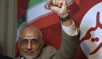 Conservative Iranian presidential candidate Mostafa Mirsalim clenches his fist at the conclusion of his news conference in Tehran, Iran, Sunday, April 23, 2017. (AP Photo/Vahid Salemi)