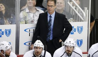 FILE - In this Thursday, Oct. 30, 2014, file photo, Los Angeles Kings assistant coach John Stevens stands behind his bench during the first period of an NHL hockey game against the Pittsburgh Penguins in Pittsburgh. A person with direct knowledge of the situation tells The Associated Press that the Los Angeles Kings will name Stevens their next head coach. Stevens replaces Darryl Sutter after serving as a Kings assistant and then associate coach for the past eight seasons, which included two Stanley Cups. (AP Photo/Gene J. Puskar, File)