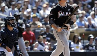 Miami Marlins' Justin Bour, right, watches his three-run home run with San Diego Padres catcher Luis Torrens watching during the sixth inning of a baseball game in San Diego, Sunday, April 23, 2017. (AP Photo/Alex Gallardo)