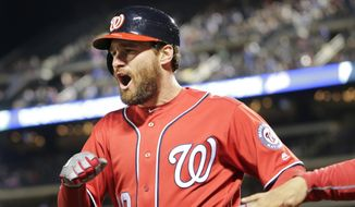 Washington Nationals' Daniel Murphy reacts after hitting a grand slam during the first inning of the baseball game against the New York Mets at Citi Field, Sunday, April 23, 2017, in New York. (AP Photo/Seth Wenig)