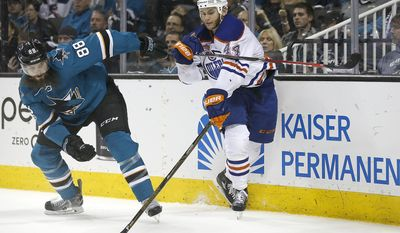 San Jose Sharks defenseman Brent Burns (88) battles for a puck against Edmonton Oilers right wing Zack Kassian (44) during the second period in Game 6 of a first-round NHL hockey playoff series Saturday, April 22, 2017, in San Jose, Calif. (AP Photo/Tony Avelar)