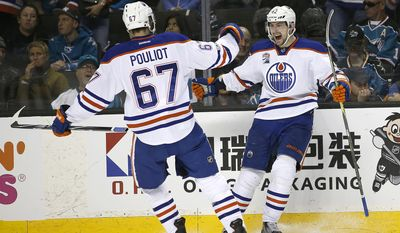 Edmonton Oilers left wing Anton Slepyshev (42) celebrates after scoring a goal with teammate Benoit Pouliot (67) during the second period against the San Jose Sharks in Game 6 of a first-round NHL hockey playoff series Saturday, April 22, 2017, in San Jose, Calif. (AP Photo/Tony Avelar)