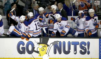 Edmonton Oilers players celebrate on the bench after a 3-1 victory against the San Jose Sharks in Game 6 of a first-round NHL hockey playoff series Saturday, April 22, 2017, in San Jose, Calif. (AP Photo/Tony Avelar)