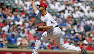 Texas Rangers starting pitcher Yu Darvish of Japan throws in the fourth inning of a baseball game against the Kansas City Royals in Arlington, Texas, Sunday, April 23, 2017. (AP Photo/Tony Gutierrez)