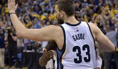 Memphis Grizzlies center Marc Gasol (33) is congratulated by forward James Ennis after making the winning basket against the San Antonio Spurs during overtime of Game 4 in an NBA basketball first-round playoff series Saturday, April 22, 2017, in Memphis, Tenn. (AP Photo/Brandon Dill)