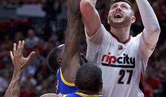 Portland Trail Blazers center Jusuf Nurkic, right, shoots over Golden State Warriors forward Draymond Green, left, and forward Andre Iguodala, center, during the second half of Game 3 of an NBA basketball first-round playoff series Saturday, April 22, 2017, in Portland, Ore. The Warriors won 119-113. (AP Photo/Craig Mitchelldyer)