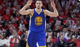 Golden State Warriors guard Klay Thompson reacts after making a three-point basket against the Portland Trail Blazers during the second half of Game 3 of an NBA basketball first-round playoff series Saturday, April 22, 2017, in Portland, Ore. (AP Photo/Craig Mitchelldyer)