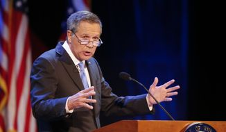 In this April 4, 2017, file photo, Ohio Gov. John Kasich delivers his State of the State address at the Sandusky State Theatre in Sandusky, Ohio. (AP Photo/Ron Schwane, File)