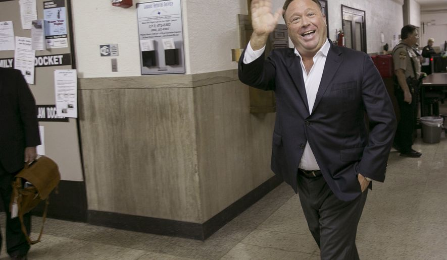 In this April 19, 2017, file photo, Alex Jones, a well-known Austin-based broadcaster and provocateur, arrives for a child custody trial at the Heman Marion Sweatt Travis County Courthouse in Austin, Texas. (Jay Janner/Austin American-Statesman via AP, File)