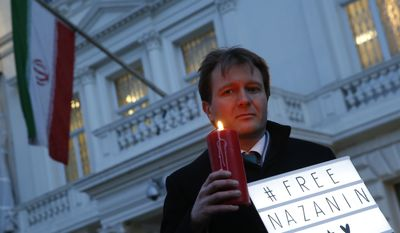 FILE -- In this Jan. 16, 2017 file photo, Richard Ratcliffe, husband of imprisoned charity worker Nazanin Zaghari-Ratcliffe, poses for the media during an Amnesty International led vigil outside the Iranian Embassy in London. The family of Zaghari-Ratcliffe who was detained in Iran while on a trip with her toddler daughter says all efforts to appeal her five-year prison sentence in court have failed. Ratcliffe, who works for the Thomson Reuters Foundation, the charitable arm of the news agency, found out this weekend that her appeal to Iran's supreme court failed. (AP Photo/Alastair Grant, File)
