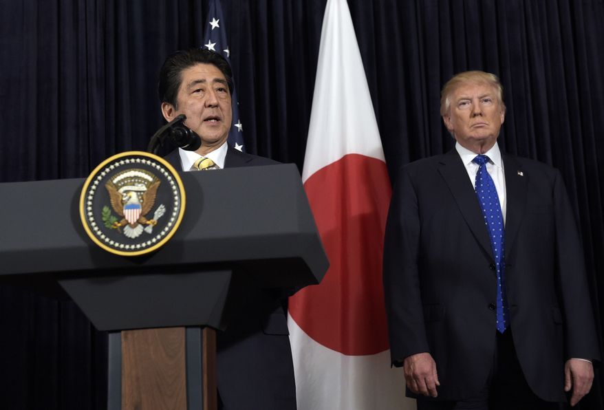 In this Saturday, Feb. 11, 2017, file photo, U.S. President Donald Trump, right, listens to Japanese Prime Minister Shinzo Abe as they make statements about North Korea at Mar-a-Lago in Palm Beach, Fla. (AP Photo/Susan Walsh, File) ** FILE **
