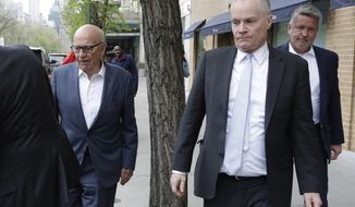 Rupert Murdoch, left, leaves a Manhattan restaurant with Fox News co-presidents Jack Abernethy, center, and Bill Shine, Monday, April 24, 2017, in New York. Last week, Fox News fired Bill O'Reilly following an investigation into harassment allegations, bringing a stunning end to the cable television news network's most popular program. (AP Photo/Mark Lennihan)