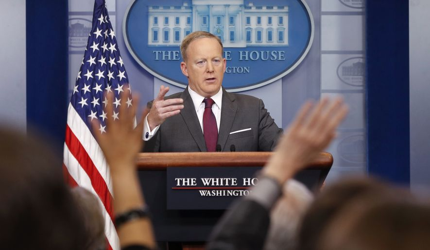 Members of the media raise their hands as White House Press secretary Sean Spicer answers questions during the daily briefing in the Brady Press Briefing Room of the White House in Washington, Monday, April 24, 2017. (AP Photo/Pablo Martinez Monsivais)