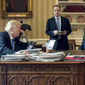President Donald Trump talks on the phone in the Oval Office with Vice President Mike Pence and Chief of Staff Reince Priebus nearby. (Associated Press photo)