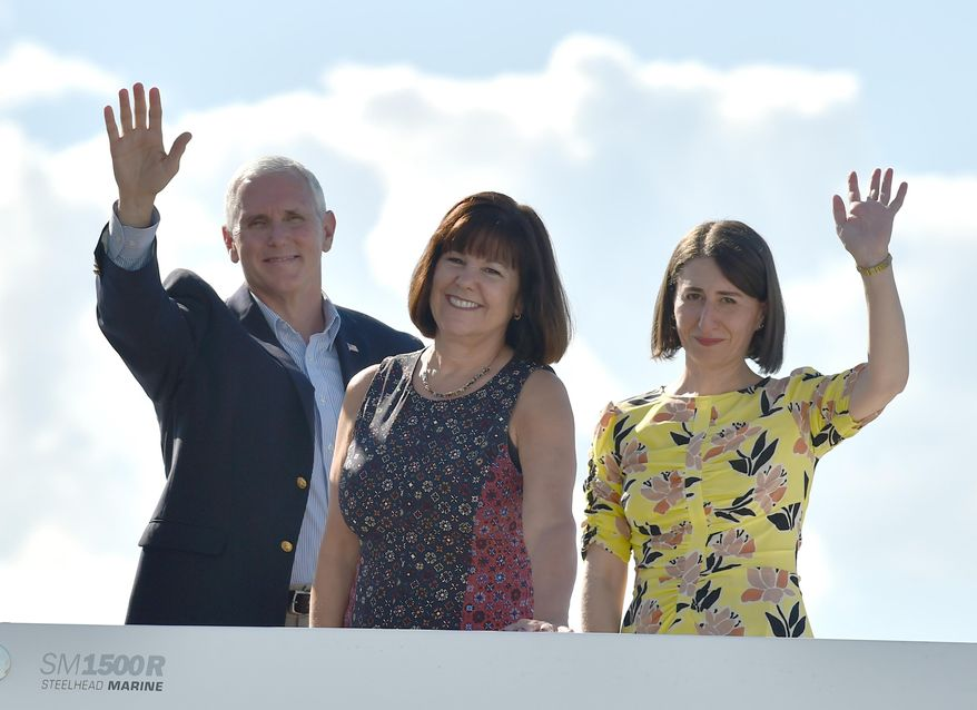 U.S. Vice President Mike Pence, left, his wife Karen, right, and New South Wales Premier Gladys Berejiklian, right, wave during a cruise on the harbor in Sydney, Sunday, April 23, 2017. Pence is on the last part of his four-country trip to Asia and Australia. (Peter Parks/Pool via AP)