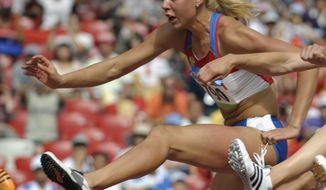 FILE - In this Aug. 15, 2008 file photo Russia's Tatiana Chernova clears a hurdle in the heptathlon during the athletics competitions in the National Stadium at the Beijing 2008 Olympics in Beijing. IOC said Monday,  April 24, 2017 that Chernova was stripped off her bronze medal after a re-analysis resulted in a positive drug test. (AP Photo/Thomas Kienzle, file)