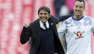 Chelsea's team manager Antonio Conte celebrates with Chelsea's John Terry, right, at the end of the English FA Cup semifinal soccer match between Chelsea and Tottenham Hotspur at Wembley stadium in London, Saturday, April 22, 2017. Chelsea won 4-2. (AP Photo/Tim Ireland)