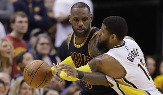 Cleveland Cavaliers' LeBron James is defended by Indiana Pacers' Paul George during the second half in Game 4 of a first-round NBA basketball playoff series, Sunday, April 23, 2017, in Indianapolis. Cleveland defeated Indiana 106-102 and won the series 4-0. (AP Photo/Darron Cummings)