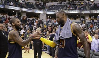 Cleveland Cavaliers' LeBron James, right, and Kyrie Irving celebrate after Cleveland defeated the Indiana Pacers 106-102 to win Game 4 of a first-round NBA basketball playoff series, Sunday, April 23, 2017, in Indianapolis. Cleveland won the series 4-0. (AP Photo/Darron Cummings)