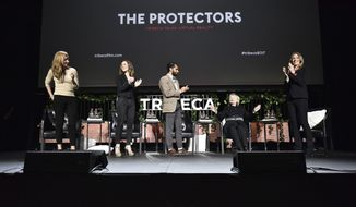 """Director at African Parks Andrea Heydlauff, from left, Executive Vice President of Digital Product at National Geographic Partners Rachel Webber, writer/director Imraan Ismail, former U.S. Secretary of State Hillary Clinton and writer/director and producer Kathryn Bigelow speak on stage at """"Tribeca Talks Virtual Reality: The Protectors,"""" during the 2017 Tribeca Film Festival at Spring Studios Saturday, April 22, 2017, in New York. Clinton was an unannounced panelist, there to discuss the scourge of elephant poaching — the subject of Bigelow's eight-minute film, """"The Protectors: Walk in the Rangers' Shoes."""" (Anthony Behar/National Geographic via AP)"""