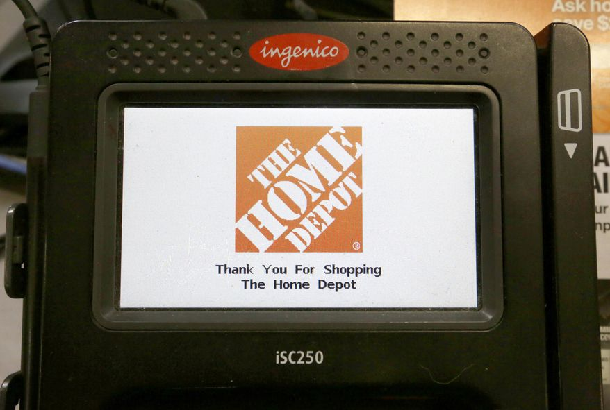 """In this Wednesday, May 18, 2016, photo, the Home Depot logo appears on a credit card reader at a Home Depot store in Bellingham, Mass. The Home Depot Inc. says in a new federal lawsuit that Visa and MasterCard are using security measures prone to fraud, putting it and other retailers at risk of hacking attacks by cyber thieves. Atlanta-based Home Depot says new payment cards with so-called """"chip"""" technology, rolled out in the U.S. in recent years, remain less secure than cards used in Europe and elsewhere in the world. (AP Photo/Steven Senne)"""