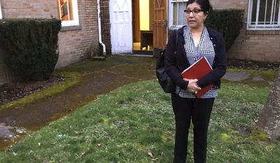 In this March 1, 2017, photo, Marta Guembes, Guatemala's honorary consul in Portland, Ore., talks about how she has been trying to help Guatemalan immigrants who were detained in the predominantly Latino town, during an interview in Woodburn, Ore. Speaking outside the offices of PCUN, a union representing farmworkers, nursery and reforestation workers in Oregon, Guembes says such detentions cause enormous pain for families in Woodburn and in Guatemala that receive money from relatives working in the U.S. (AP Photo/Andrew Selsky)