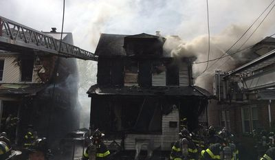 In this photo provided by the New York City Fire Department, firefighters work to put out a deadly house fire in the Queens Village neighborhood of the Queens borough of New York, Sunday, April 23, 2017. Investigators are scouring for clues about what sparked a fast-moving New York City house fire that killed multiple people. (New York City Fire Department via AP)