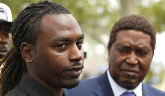 Nandi Cain, left, discusses the beating he received from a Sacramento Police officer two weeks ago during a news conference Monday, April 24, 2017, in Sacramento, Calif. Cain's attorney, John Burris, right, announced that a federal civil rights lawsuit has been filed against the city and county of Sacramento for allegations that Cain was beaten by Sacramento Police Officer Anthony Figueroa, who had stopped Cain for jaywalking. (AP Photo/Rich Pedroncelli)