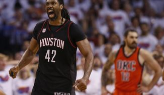 Houston Rockets center Nene (42) celebrates a basket in front of Oklahoma City Thunder center Steven Adams (12) in the fourth quarter of Game 4 of a first-round NBA basketball playoff series in Oklahoma City, Sunday, April 23, 2017. Houston won 113-109. (AP Photo/Sue Ogrocki)