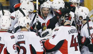 Ottawa Senators' Clarke MacArthur (16) celebrates with teammates after scoring during overtime in game six of a first-round NHL hockey Stanley Cup playoff series against the Boston Bruins, Sunday, April 23, 2017, in Boston. The Senators won 3-2. (AP Photo/Michael Dwyer)