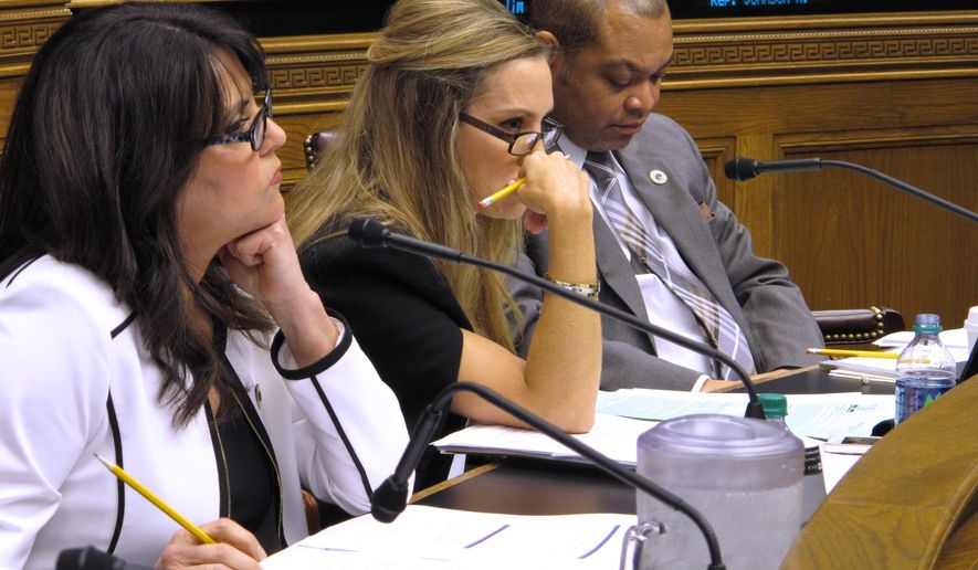 Reps. Dodie Horton, R-Haughton; Paula Davis, R-Baton Rouge; and Jimmy Harris, D-New Orleans, from left to right, listen to testimony about Gov. John Bel Edwards' gross receipts tax proposal, on Monday, April 24, 2017, in Baton Rouge, La. (AP Photo/Melinda Deslatte)