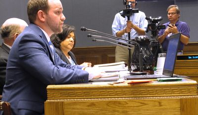 Luke Morris, assistant director of the State Revenue department, left, describes to lawmakers the details of Gov. John Bel Edwards' gross receipts tax proposal while Revenue Secretary Kimberly Robinson listens, on Monday, April 24, 2017, in Baton Rouge, La. (AP Photo/Melinda Deslatte)