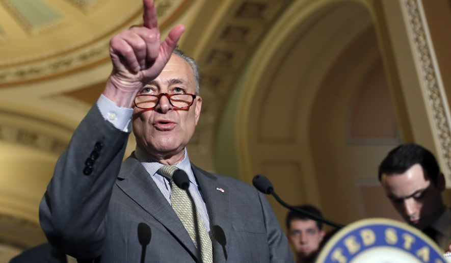 Senate Minority Leader Charles Schumer of N.Y. points to a reporter during a media availability after a policy luncheon, Tuesday, April 25, 2017, on Capitol Hill in Washington. (AP Photo/Alex Brandon)