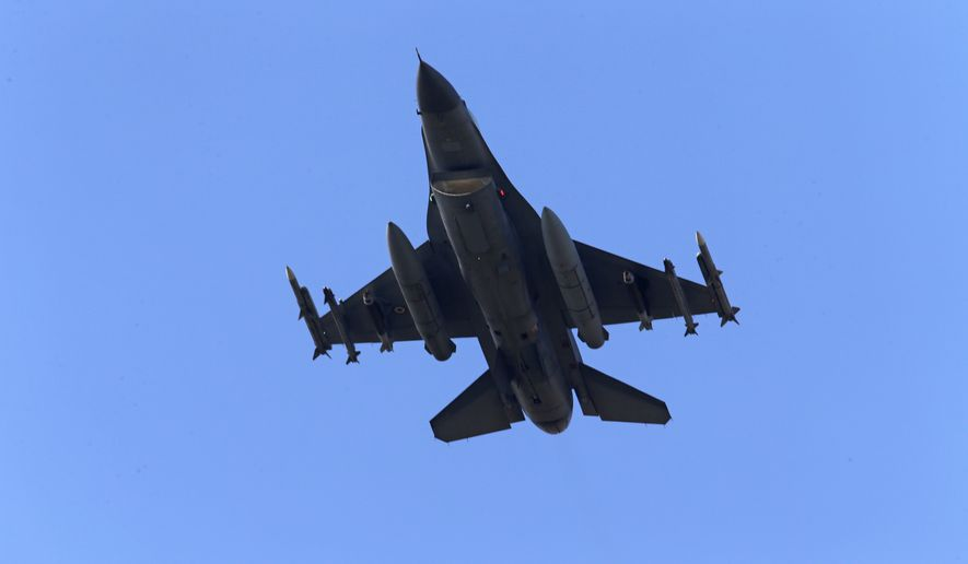 In this July 29, 2015, file photo, a Turkish Air Force warplane rises in the sky after taking off from Incirlik Air Base, in Adana, southern Turkey. On Tuesday, April 25, 2017, Turkish warplanes carried out airstrikes against suspected Kurdish rebel positions in northern Iraq and in northeastern Syria, the military said, in a bid to prevent militants from smuggling fighters and weapons into Turkey. Although Turkey regularly carries out airstrikes against outlawed Kurdistan Workers' Party, or PKK targets in northern Iraq, this was the first time it has struck the Sinjar region. (AP Photo/Emrah Gurel, File)