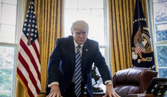 President Donald Trump poses for a portrait in the Oval Office in Washington in this Friday, April 21, 2017, file photo. Trump will mark the end of his first 100 days in office with a flurry of executive orders as he looks to fulfill campaign promises and rack up victories ahead of that milestone. (AP Photo/Andrew Harnik, File)
