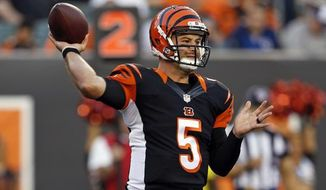 FILE - In this Sept. 1, 2016, file photo, Cincinnati Bengals' AJ McCarron (5) throws against the Indianapolis Colts during the first half of an NFL football game in Cincinnati. Bengals backup quarterback McCarron is looking at another year of barely getting on the field, and maybe longer. (AP Photo/Frank Victores, File)