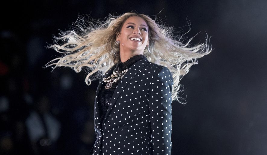 "FILE - In this Nov. 4, 2016, file photo, Beyonce performs at a Get Out the Vote concert for Democratic presidential candidate Hillary Clinton at the Wolstein Center in Cleveland. Beyonce marked the one-year anniversary of her album ""Lemonade"" on April 25, 2017, by announcing scholarships for black women to attended selected colleges. (AP Photo/Andrew Harnik, File)"