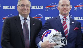 FILE - In this Jan. 13, 2017, file photo, Buffalo Bills NFL football team new head coach Sean McDermott poses for a photograph with team owner Terry Pegula, left, during a press conference in Orchard Park, N.Y. Don't underestimate the impact Bills first-time coach Sean McDermott has had on Buffalo's multi-sport franchise owner Terry Pegula. When Pegula outlined last week the issues he found lacking _ discipline, structure and character _ in his NHL Sabres, they resemble the same troubles he believes he addressed in hiring the 42-year-old, detail-oriented McDermott, who will have a prominent influence in the Bills draft this weekend.(AP Photo/Jeffrey T. Barnes, File)