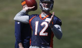 Denver Broncos quarterback Paxton Lynch takes part in drills during a voluntary veteran minicamp at the team' headquarters Tuesday, April 25, 2017, in Englewood, Colo. (AP Photo/David Zalubowski)