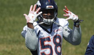 Denver Broncos outside linebacker Von Miller dances during a voluntary veteran minicamp at the team' headquarters Tuesday, April 25, 2017, in Englewood, Colo. (AP Photo/David Zalubowski)