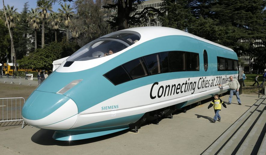 FILE - This Feb. 26, 2015, photo shows a full-scale mock-up of a high-speed train, displayed at the Capitol in Sacramento, Calif. Sacramento County Superior Court Judge Raymond Cadei said in a tentative ruling, Tuesday, April 25, 2017, that he intends to dismiss a lawsuit by opponents that would have blocked the California High Speed Rail Authority from spending about $1.25 billion in bonds sold last week. (AP Photo/Rich Pedroncelli, File)