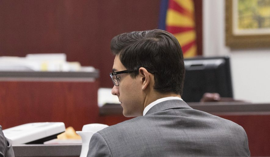 In this photo provided by Halie Chavez, Steven Jones listens to closing statements on Tuesday, April 25, 2017, in Flagstaff, Ariz. Closing arguments began Tuesday, April 25, in Jones' murder trial, who killed one student and wounded three others in what he said was self-defense after being punched in the face just a few weeks into his freshman year in October 2015. (Halie Chavez/The Lumberjack via AP)