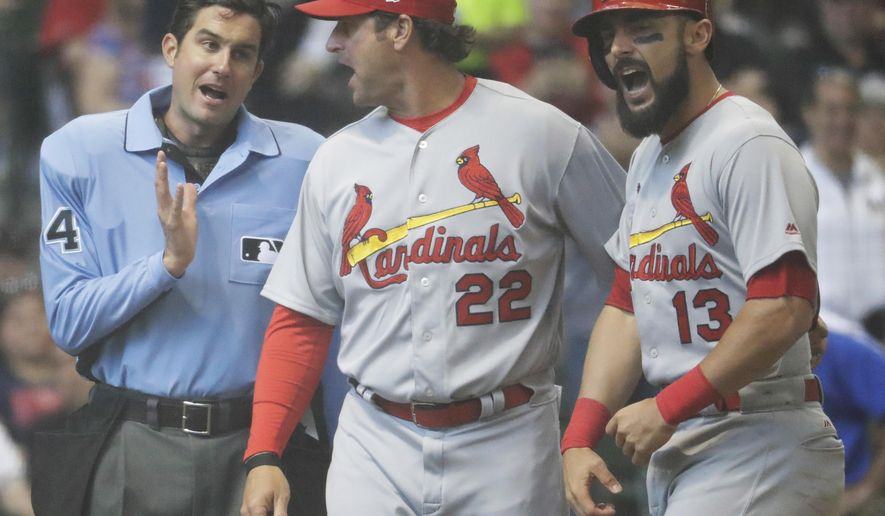 St. Louis Cardinals manager Mike Matheny holds back Matt Carpenter (13) as he talks to hoe plate umpire John Tumpane after Carpenter was ejected for arguing a called strike three during the seventh inning of a baseball game Sunday, April 23, 2017, in Milwaukee. (AP Photo/Morry Gash)