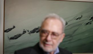 German painter Gerhard Richter stands in front of his work during a press preview for his exhibition downtown Prague, Czech Republic, Tuesday, April 25, 2017. The exhibition starts on April 26, 2017 and last until Sept. 3, 2017. (AP Photo/Petr David Josek)