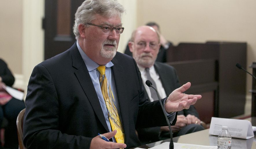 Bill Croyle, left, the acting director of the Department of Water Resources, discusses the damaged spillway on the Oroville Dam during a hearing of the Senate of the Natural Resources and Water Committee, Tuesday, April 25, 2017, in Sacramento, Calif. Croyle and Natural Resources Secretary John Laird, right, updated lawmakers on the actions taken to repair the damaged spillway that caused the evacuation of nearly 200,000 people downstream of the Oroville Dam in February. (AP Photo/Rich Pedroncelli)