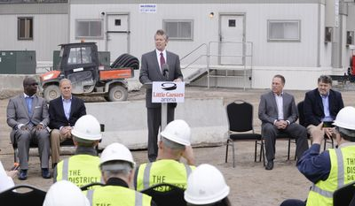 Tom Wilson, center, Olympia Entertainment President & CEO, speaks, as, seated from left, Detroit Mercy coach Bacari Alexander, Michigan coach, John Beilein, Michigan State coach, Tom Izzo, Oakland University coach and Greg Kampe, listen during a press conference outside the new Little Caesars Arena, Tuesday, April 25, 2017,  in Detroit. The new arena will host a college basketball doubleheader on Dec. 16, with Michigan facing Detroit and Michigan State playing Oakland. (Clarence Tabb Jr./Detroit News via AP)