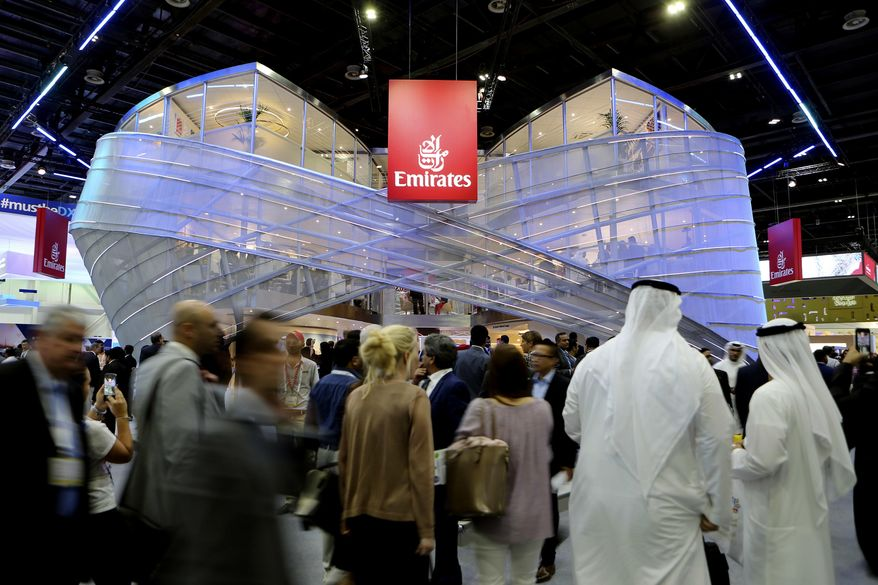 """People visit the Emirates stand during the Arabian Travel Market Exhibition in Dubai, United Arab Emirates, Tuesday, April 25, 2017. The chairman and CEO of Dubai's long-haul carrier Emirates says he """"can't dig into somebody's mind"""" to understand why the U.S. instituted a ban on laptops and other personal electronics in carry-on luggage from 10 cities in Muslim-majority countries. (AP Photo/Kamran Jebreili)"""