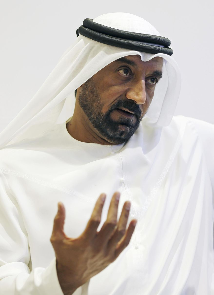 """Sheikh Ahmed bin Saeed Al Maktoum, President of the Department of Civil Aviation, CEO and Chairman of The Emirates Group talks with the journalists during the Arabian Travel Market Exhibition, in Dubai, United Arab Emirates, Tuesday, April 25, 2017. The chairman and CEO of Dubai's long-haul carrier Emirates says he """"can't dig into somebody's mind"""" to understand why the U.S. instituted a ban on laptops and other personal electronics in carry-on luggage from 10 cities in Muslim-majority countries. (AP Photo/Kamran Jebreili)"""