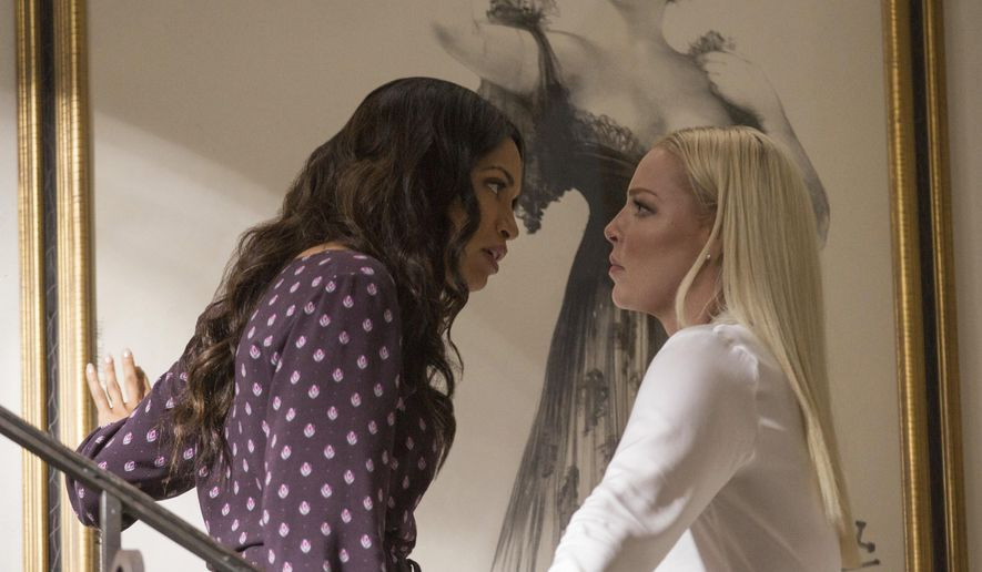 "This image released by Warner Bros. Pictures shows Rosario Dawson, left, and Katherine Heigl in a scene from ""Unforgettable."" (Karen Ballard/Warner Bros. Pictures via AP)"